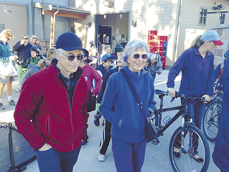 Mayor Jim Clinton and Judy Clinton walk with Elk Meadow Students during Walk & Bike to school day. Photo provided by Commute Options.