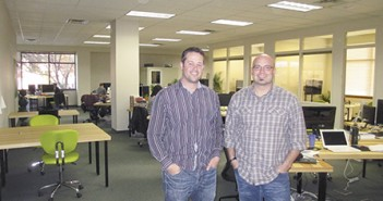 Isaac Tolpin & Chris Behnke of Choose Growth standing in their SW Bend office. Photo by Gregg Morris