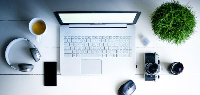canva-photography-of-laptop-computer-camera-smartphone-headphones-and-mug